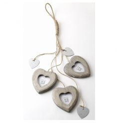 Hanging heart photo frames on string with metal heart cut outs. Very popular line