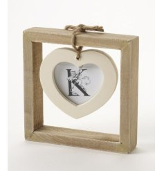 Very simple wooden photograph frame with a single cream heart frame hanging in the centre