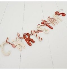 Red and white rustic, wooden Christmas garland. Very popular Christmas decoration