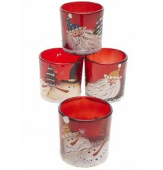 Small painted tea light holders with cute Santa and snowman motifs