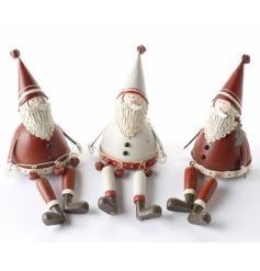 An assortment of red and white sitting Santas each with their own charm