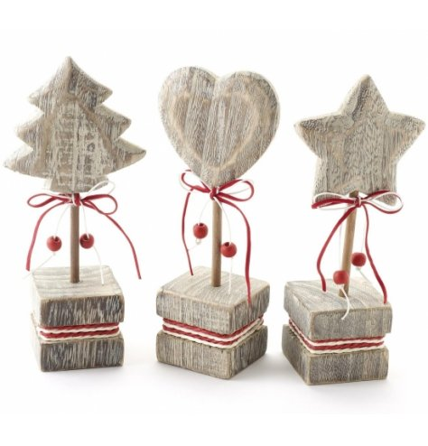 Tree, heart and star design rustic Christmas ornaments on red and white twine wrapped stands.