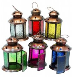 An assortment of moroccan inspired glass lanterns, each set with its own coloured panelling