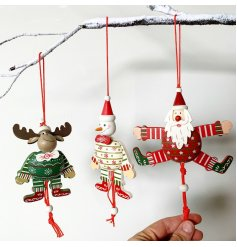 A mix of hanging wooden Christmas Characters dressed up in festive attire