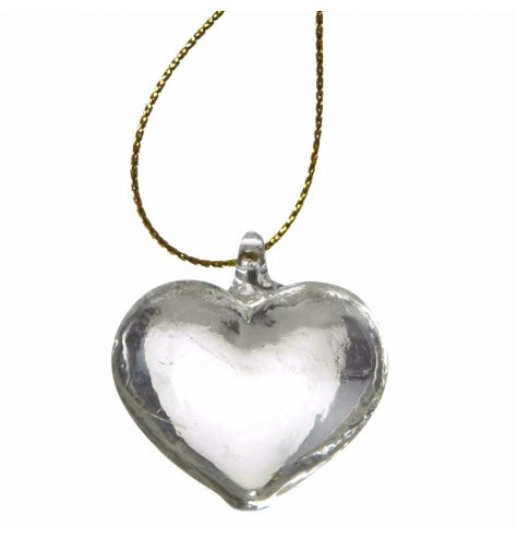 A chic glass heart decoration with a gold string hanger. A translucent Christmas decoration with glass hook.