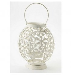 Cream metal candle holder decorated with snowflakes