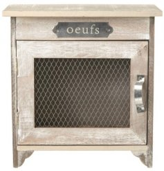 A french themed wooden egg cabinet with added white washed tones and a mesh door