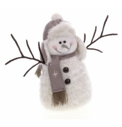 A cute snowman figurine with a fluffy body and twig arms