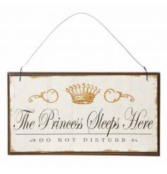 A hanging wooden plaque set with a vintage inspired detail and scripted text quote