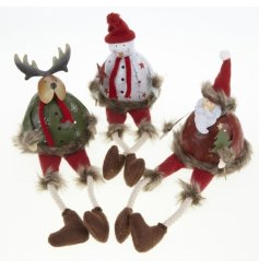 Three sitting metal decorations in quirky santa, snowman and reindeer designs.