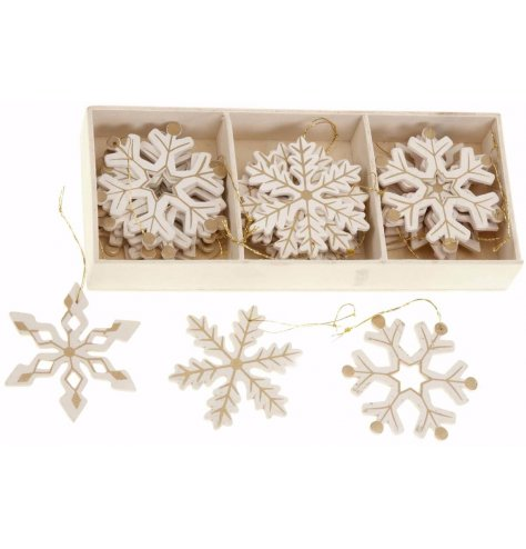A set of 24 wooden snowflake hanging decorations with gold patterns and gold hangers.