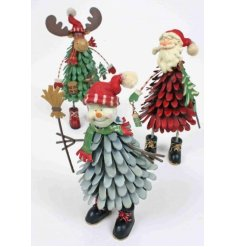 A festive assortment of standing metal Christmas Characters, each set with Nordic inspired colours and decals