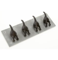 A rustic slate tile with dog tail hooks
