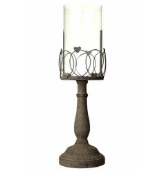 A large rustic metal candle holder set with added heart decals and a distressed theme