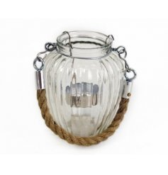 A ridged glass candle holder complete with a chunky rope hanger