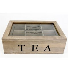 A natural wooden storage box with added separated compartments and a printed glass lid