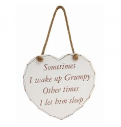 Humorous wooden plaque in white with cream text and jute rope to hang.