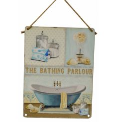 A beautifully vintage inspired metal sign with a scripted text and bathroom illustration