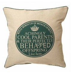 Natural square cushion with green plaque and trim reading 'achingly cool parents and their perfectly behaved offspring