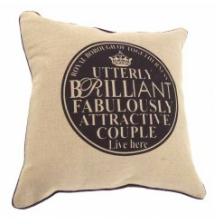 Chic natural cushion with printed couple plaque reading 'utterly brilliant, fabulously attractive couple lives here'.