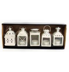 Cream coloured lanterns in assorted designs. Set of 5