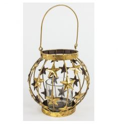 Small gold lantern with multiple star design and glass votive.