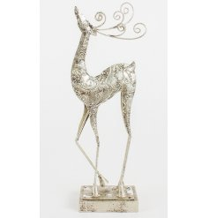Silver metal standing reindeer with a decorative finish and swirly antlers.