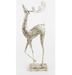 Decorative standing reindeer with a silver patterned finish and swirly antlers.