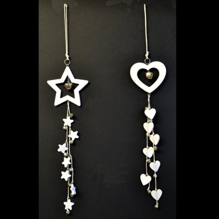 Hanging heart and star decorations with cut out design and silver bells.