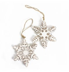 Two rustic white wooden snowflake decorations with jute string to hang.