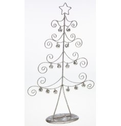 Silver wired tree with curled branches and hanging bells.