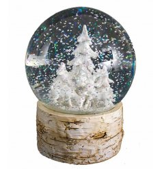 Rustic wooden globe with white winter wonderland festive scene.