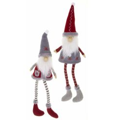 Nordic style fabric santa decorations with knitted hats, stripe tights and fur trim boots.