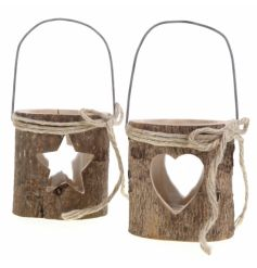 Chunky woodland style candle holders with a bark finish and star or heart cut out.