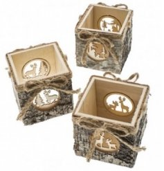 A mix of rustic candle holders with jute string handles and a stunning laser cut woodland scene.