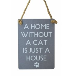 A mini metal sign featuring a block scripted text about home with a cat