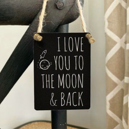 A mini metal sign with a scripted text decal and black base tone