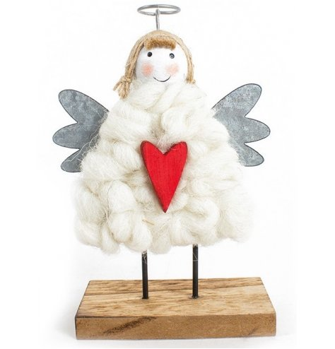 A charming wooden angel figure with a wool body, metal angel wings and red heart motif.