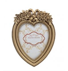 A stunning heart shaped antique style frame with beautiful bow and floral details.