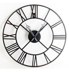A Large black metal wall clock featuring roman numeral edgings and a rustic inspired pointer
