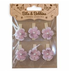 Wooden craft pegs with pretty pink flower detail