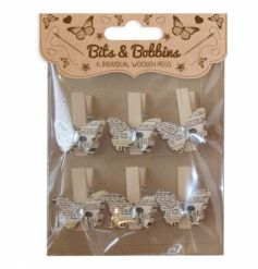 A pack of 6 vintage style butterfly craft pegs each with a gem.