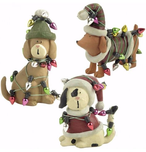 Assorted dog breed figures with red and green Christmas hats and jumpers.