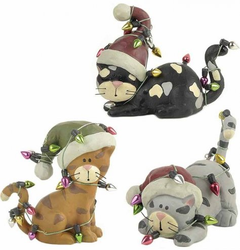 A set of 3 cute cat figures with red and green Santa hats. Each is in a tangle with coloured string lights