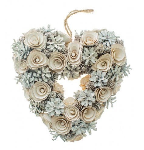 A beautifully detailed heart shaped wreath with wooden roses and pinecones in assorted sizes.