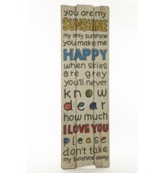 A large wooden panel sign with popular 'You Are My Sunshine' text in on trend primary colours.