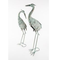 2 mint green garden herons with gold detailing and a distressed finish.