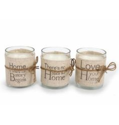 Three natural candle pots each with a linen slogan wrap and jute rope.