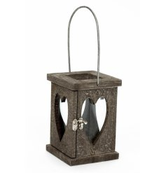 A rustic wooden lantern with a classic metal handle. Perfect for interior and exterior decor and special events.