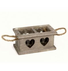 A natural wooden tray with chunky rope handles and glass heart details enclosing two t-light holders.